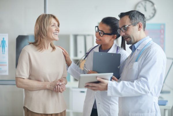 Doctors discussing treatment with patient